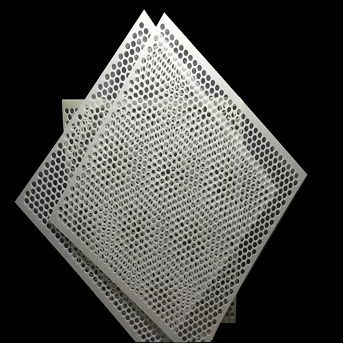 Perforated plastic sheets for layer pads for sterilization